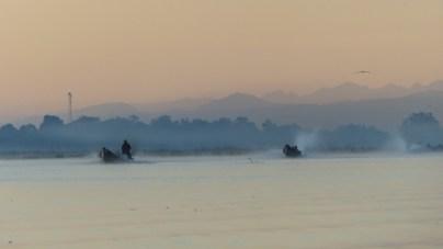 Longboats on Inle Lake before dawn