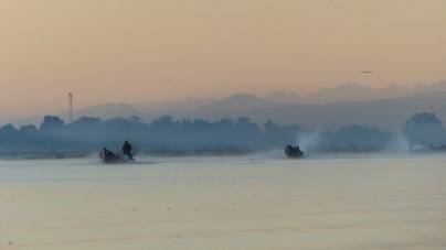 Longboats on Inle Lake before dawn