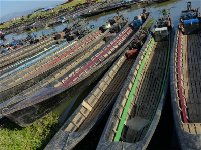 Longboats on the shore of the Inle Lake