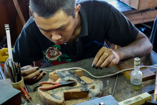 Silversmiths at Inle Lake create silver jewlery