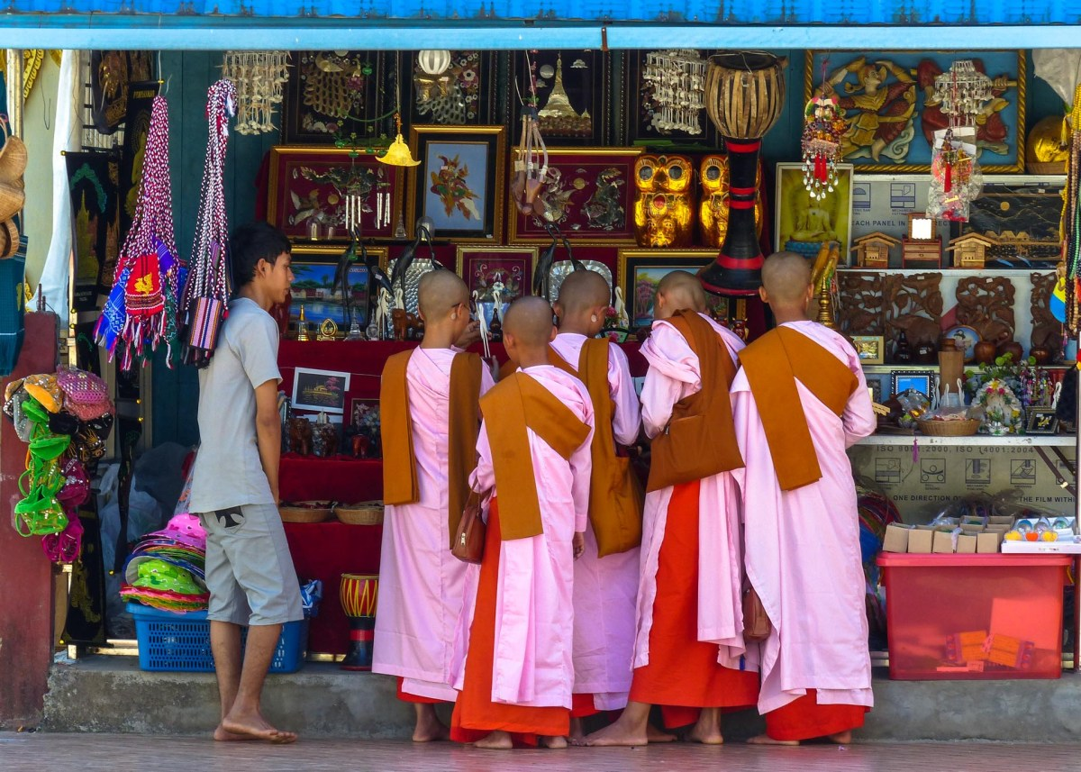 Buddhist nuns in pink robes at Kyaikthanlan pagoda in Mawlamyine