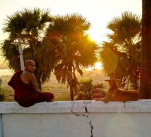 Monks and dog at the U Zina pagoda  in Mawlamyine for sunset viewing