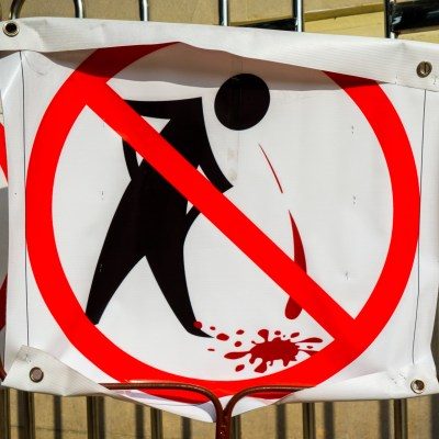 "In many public places, spitting of ""Buai Pekpek"" is forbidden"