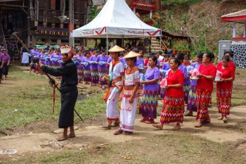 Tana Toraja Funeral Ceremony - parade in order to receive the guests Christian Jansen & Maria Düerkop