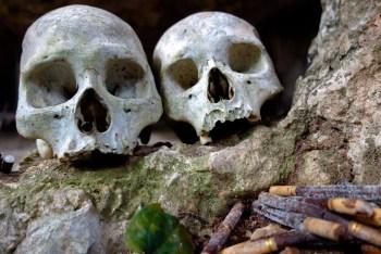 Tana Torajain - human skulls ancient funeral caves with cigarette donation for the spirits Christian Jansen & Maria Düerkop