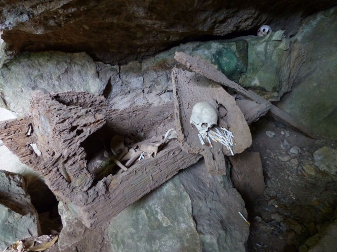 Tana Toraja - broken sarcophagus, human bones and cigarette donation in ancient funeral caves Christian Jansen & Maria Düerkop