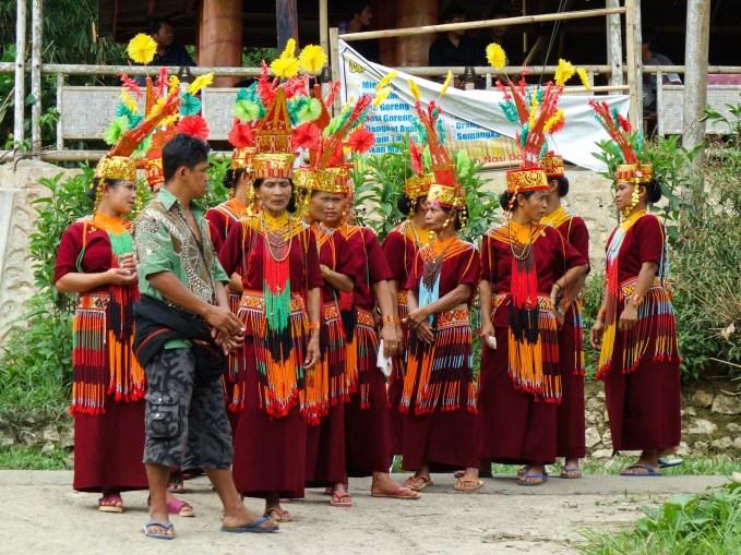 Tana Toraja Funeral Ceremony - women in traditional clothing at coffin parade through the village Christian Jansen & Maria Düerkop