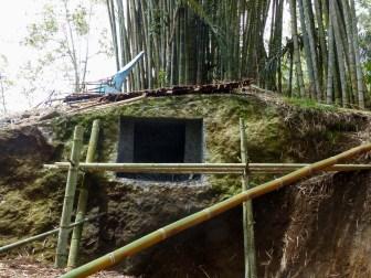 Tana Toraja - monolithic grave under construction in bamboo forest Christian Jansen & Maria Düerkop