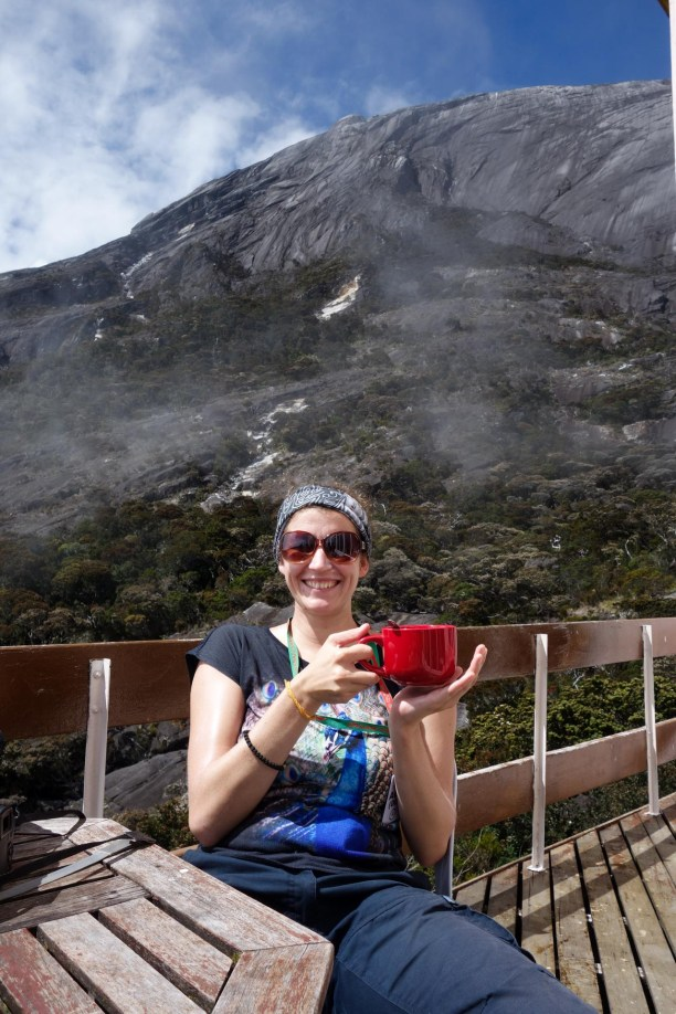 Mount Kinabalu - Bsecamp: Maria and a red cup of coffee at the sunny terrace Christian Jansen & Maria Düerkop