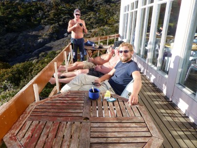 Mount Kinabalu - Basecamp: Chris dosing off on altitude sun with some drunk czechs Christian Jansen & Maria Düerkop