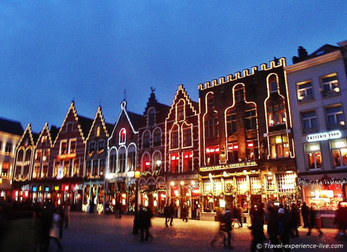 Beautifully lit houses at Bruges town square.