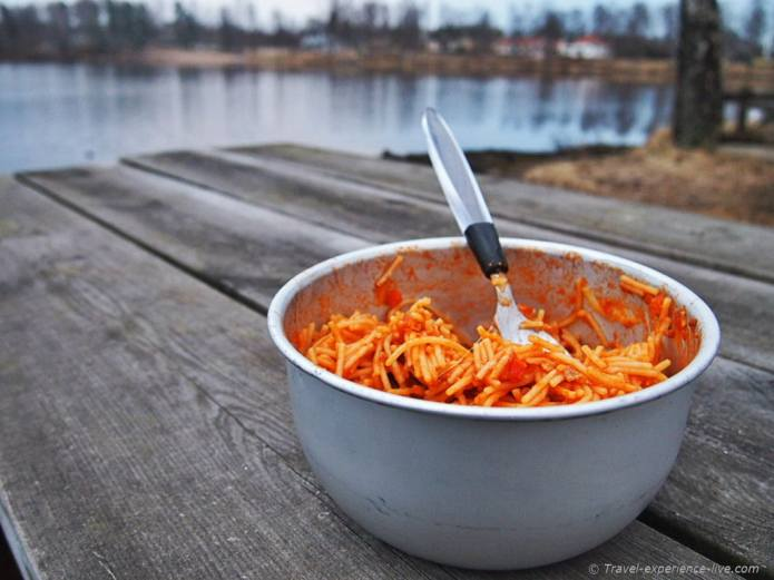 Spaghetti dinner next to a lake in Sweden.
