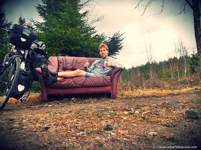 Resting on a couch in the woods in Sweden.