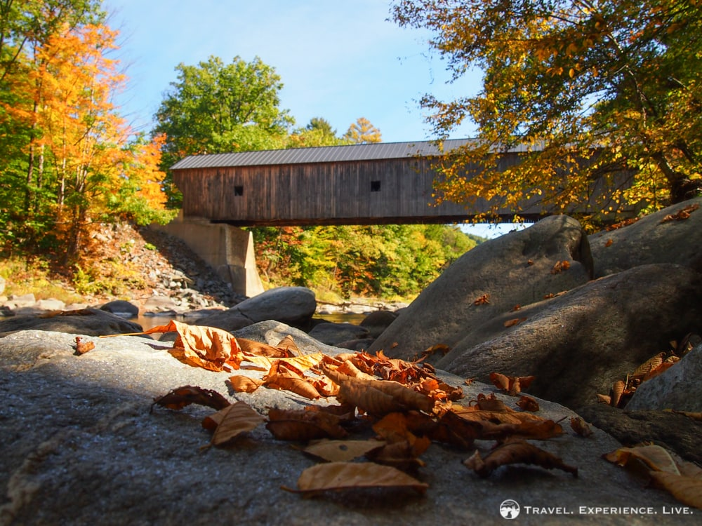 Fall in New England: leaves and a covered bridge