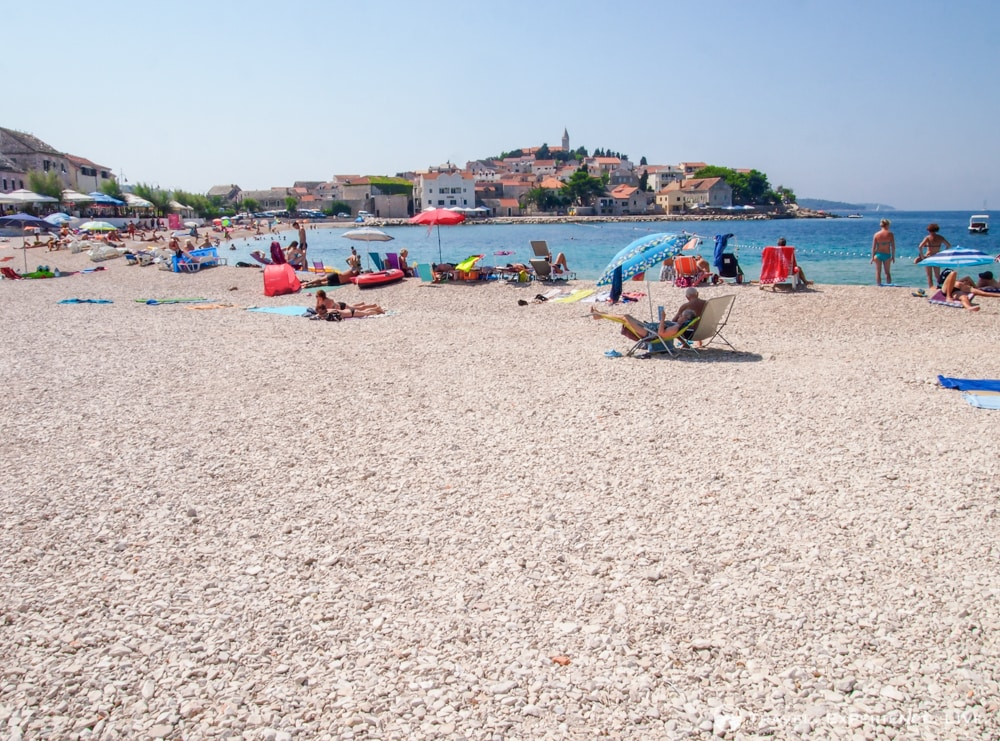Pebble beach in the gorgeous town of Primošten, Croatia