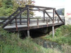 Wooden bridge over stream Škofeljščica