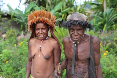 This man and lady in traditional dress agreed to a photograph near Widangku