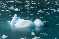 Iceberg Floating by Mergerie Glacier
