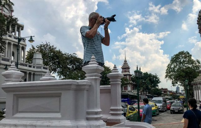 Andrea taking a photo while traveling in Bangkok Thailand