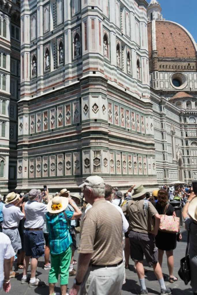 Summer tourists by the Duomo in Florence Italy - crowded!