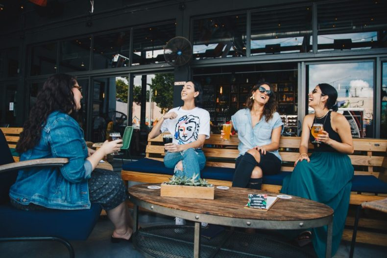 Four women meeting up while traveling solo