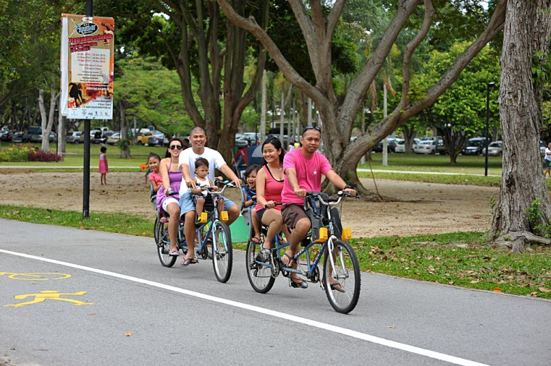 Locals In Singapore Visit a Park and Cycle