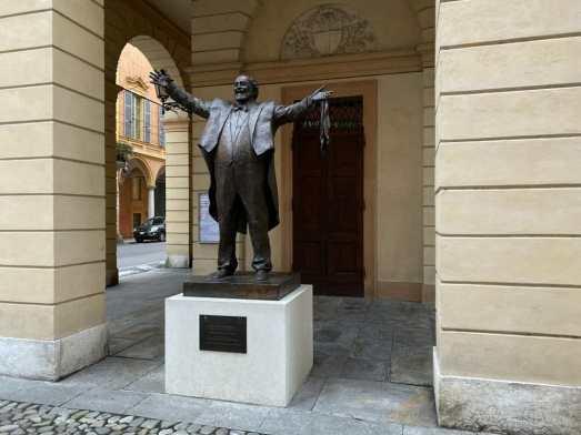 Pavarotti Statue in front of the Pavarotti Theatre Modena