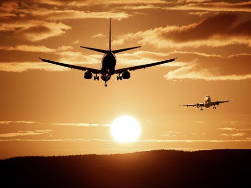 TravelAfter5_Dumb Money Saving_Two Aircrafts against Sun