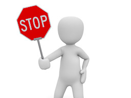 TravelAfter5_Dumb Money-Saving_Doll Holding Stop Sign