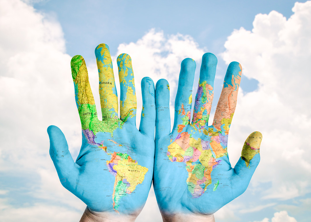 TravelAfter5_Travel More in 2020_world map painted on hands