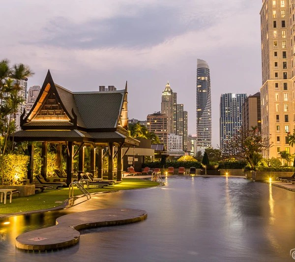Outdoor pool and city views at Plaza Athenee Bangkok