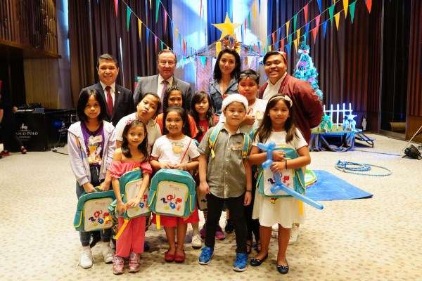Marco Polo Ortigas Manila's Resident Manager Roel Constantino and General Manager Frank Reichenbach with the kids from Riversprings School.