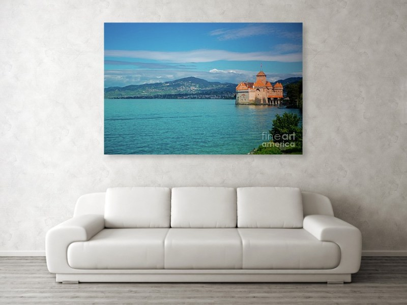 Large acrylic print of European castle Chateau Chilon on Lake Geneva hanging over a white couch