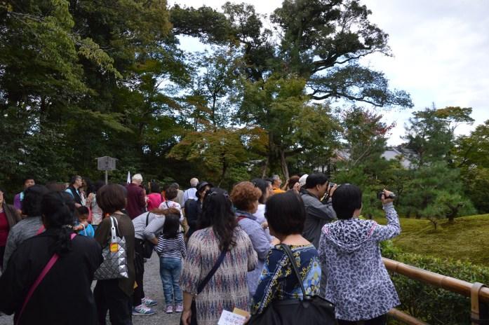 Tourists at Kinkaku-ji (Golden Pavilion), Kyoto, Japan