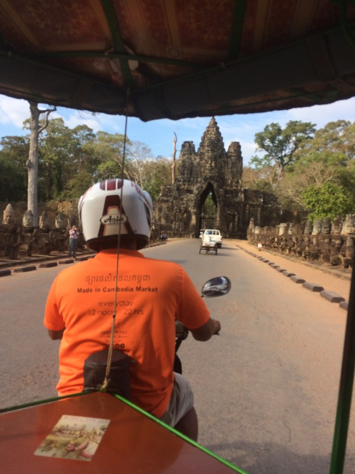 Driving through one of the gates to Angkor Thom, Angkor Archaeological Park, Cambodia