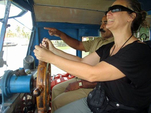 driving ferry in India next to skipper