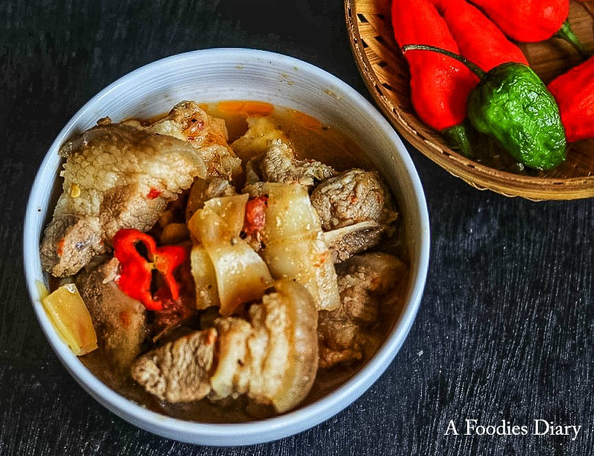 Authentic Assamese Food: Baah Gaaj Bhoot jolokia di Gahori(Pork with bamboo shoots and king chilly)