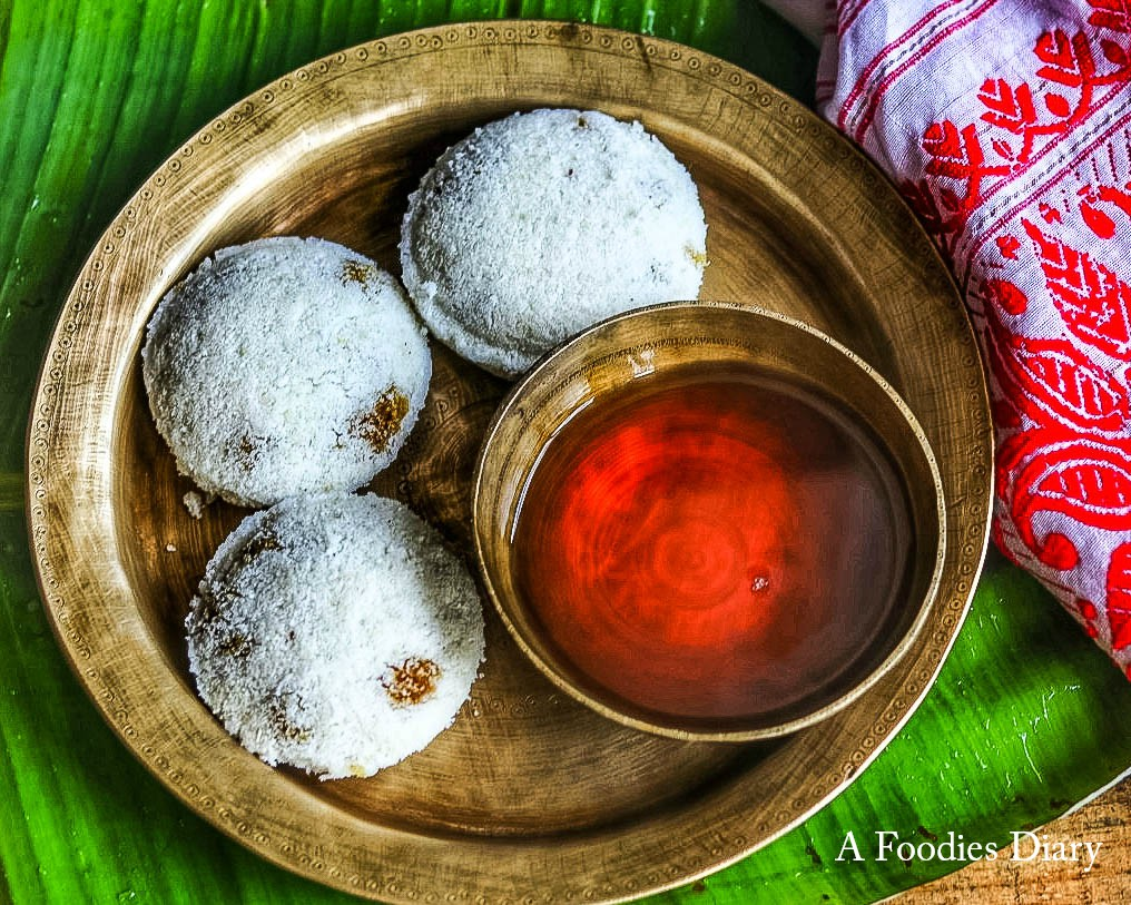Authentic Assamese Food: Tekeli pitha and Laal Saah ( Steamed Rice cake with Red Tea)