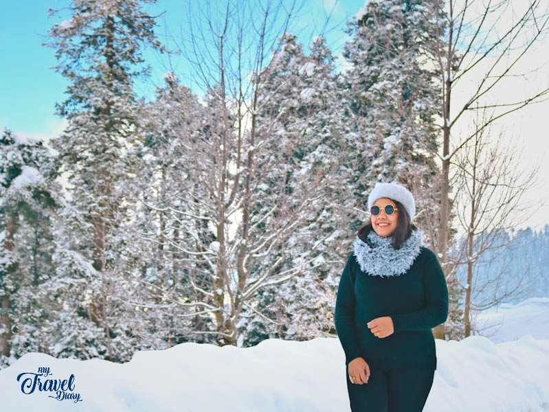 Me with a gorgeous snow backdrop in Gulmarg