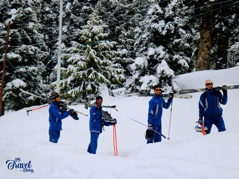 Men returning from skiing