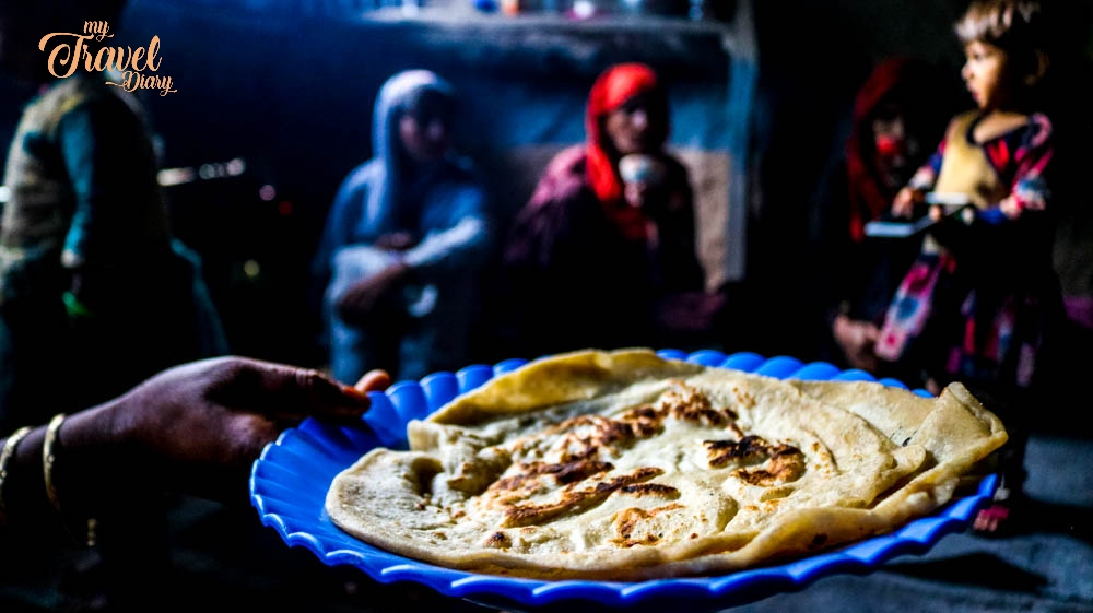 Doodh Roti (Milk Bread) being offered to me by the Bakarwal Community