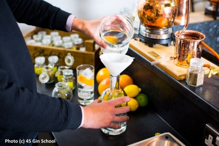 Blending water with distillate at Gin School