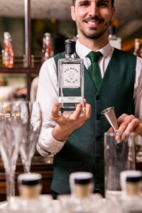 Palmers London Dry Gin bottle and bartender