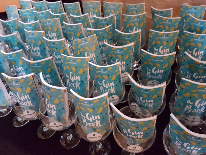 Gin book and welcome coupe glass at the Peterborough Gin Festival