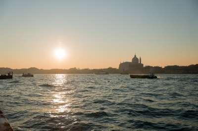 Sun rising over a frozen Venice Italy