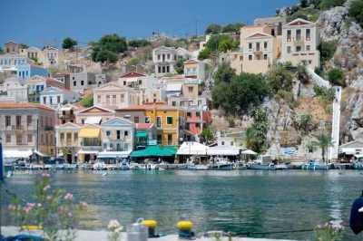 Colourful houses around the Symi Greece harbour