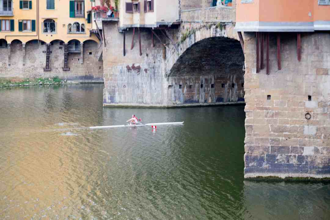 Rower on the Arno River