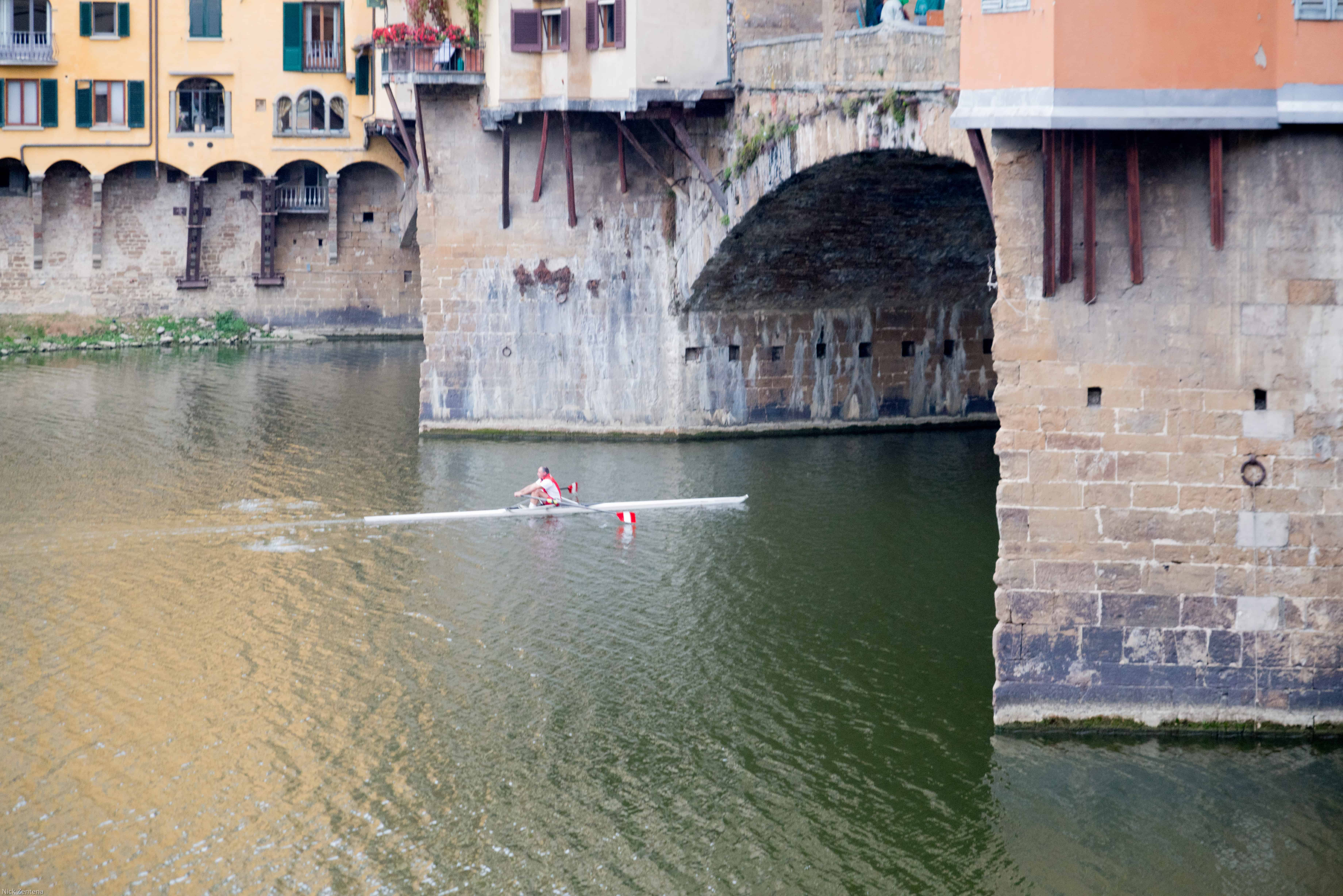 Rower on the Arno River Florence Italy