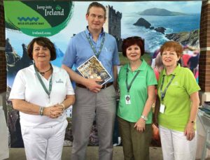 Minister Seán Kyne with Úna Galligan, Marie Duffy and Marie McKown, all Tourism Ireland, at the annual Milwaukee Irish Fest.