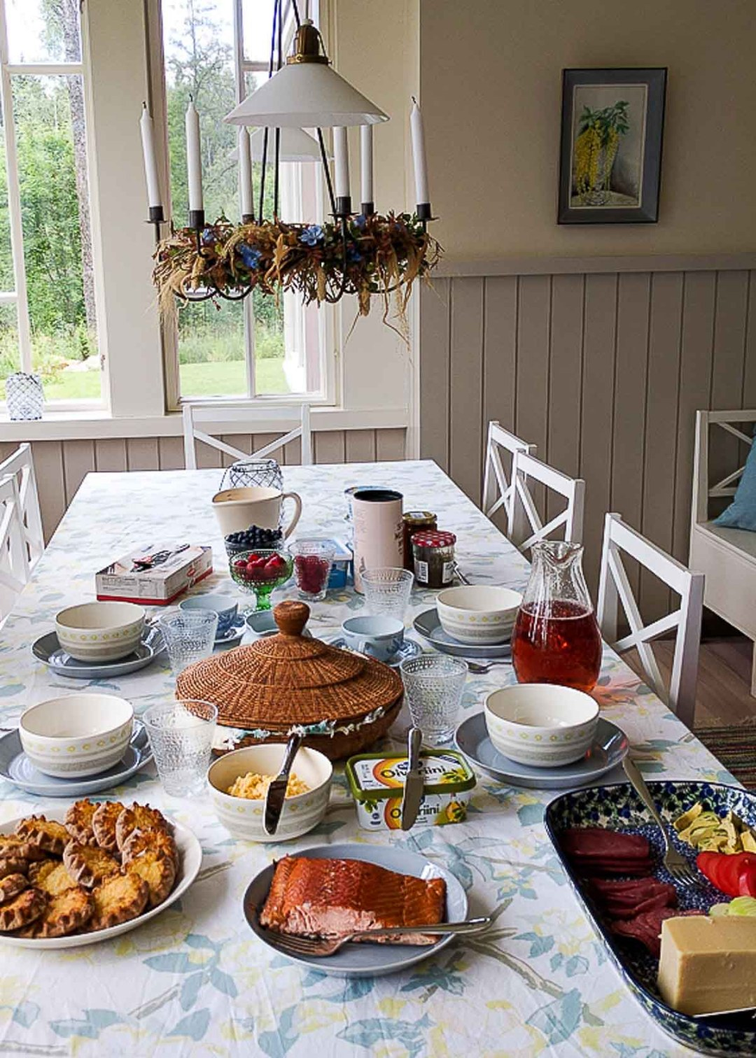 Finnish brunch at a gorgeous table with spring decor. The brunch features salmon, reindeer meat, and Finnish pastry.